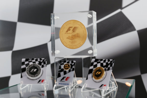 Silverstone, Northamptonshire, UK Friday 8 July 2016. Rosland Capital launch their unique, limited collection of gold and silver F1 coins, celebrating the history the FIA Formula One World Championship. A special edition 1/4oz British GP Gold Coin is announced, as well as the introduction of their 1kg F1 Gold Coin -  one of only 15 to be made this year. In addition, they are also launching two other F1 coins: a 2.5oz Silver Coin and 2.5oz Gold Coin. World Copyright: FerraroLAT Photographic ref: Digital Image _FER0175
