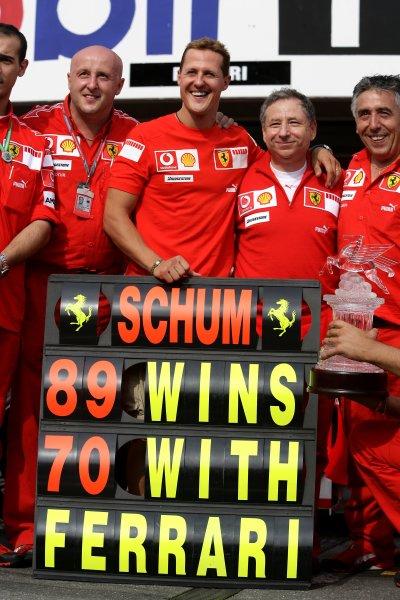 2006 German Grand Prix - Sunday Race Hockenheim, Germany. 27th - 30th July. Michael Schumacher, Ferrari 248F1, 1st position, celebrates his 89th win and 70th for Ferrari, portrait. World Copyright: Charles Coates/LAT Photographic ref: Digital Image ZK5Y2572