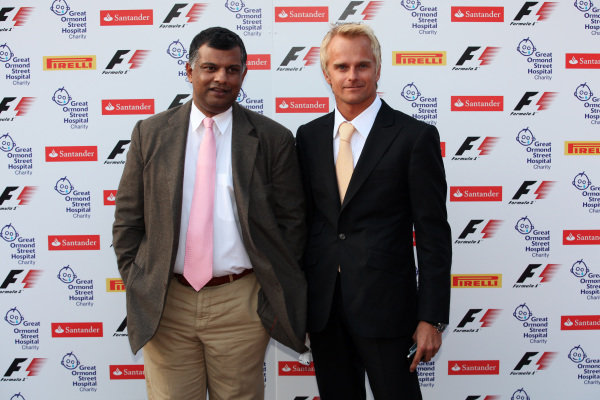 Tony Fernandes (MAL) Team Lotus GP Team Principal and Heikki Kovalainen (FIN) Team Lotus.