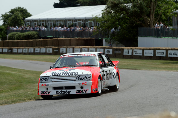 2005 Goodwood Festival of SpeedGoodwood Estate, West Sussex. 24th - 26th June Peter Brock in the Holden Commodore VK. Action World Copyright: Gary Hawkins/LAT Photographicref: Digital Image Only