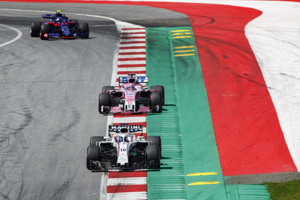 Lance Stroll, Williams FW41 Mercedes, leads Sergio Perez, Force India VJM11 Mercedes, and Pierre Gasly, Toro Rosso STR13 Honda.