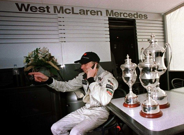 1997 European Grand Prix.Jerez, Spain.24-26 October 1997.Mika Hakkinen (McLaren Mercedes-Benz) on the mobile phone after his maiden Grand Prix victory.World Copyright - LAT Photographic