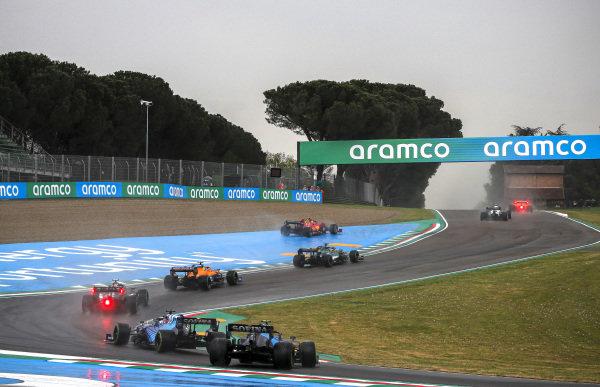 Carlos Sainz, Ferrari SF21, runs wide ahead of Lance Stroll, Aston Martin AMR21, Lando Norris, McLaren MCL35M, Valtteri Bottas, Mercedes W12, and Fernando Alonso, Alpine A521, as Nicholas Latifi, Williams FW43B, spins