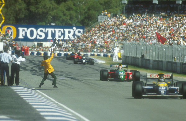 1990 Australian Grand Prix.Adelaide, Australia.2-4 November 1990.Nelson Piquet (Benetton Ford) takes the chequered flag for 1st position, with Nigel Mansell (Ferrari 641) 2nd position not far behind.Ref-90 AUS 05.World Copyright - LAT Photographic