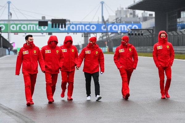 Sebastian Vettel, Ferrari walks the track with members of the Ferrari team