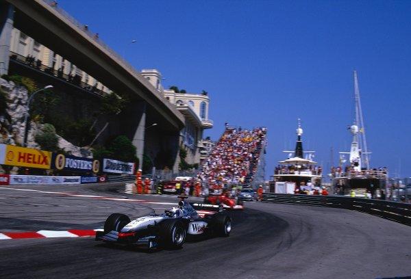 2002 Monaco Grand Prix.Monte Carlo, Monaco. 23-26 May 2002.David Coulthard (McLaren MP4/17 Mercedes) 1st position with Michael Schumacher (Ferrari F2002) behind at the Nouvelle Chicane.Ref-02 MON 03.World Copyright - LAT Photographic