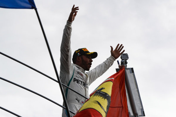 Lewis Hamilton, Mercedes AMG F1, celebrates on the podium.