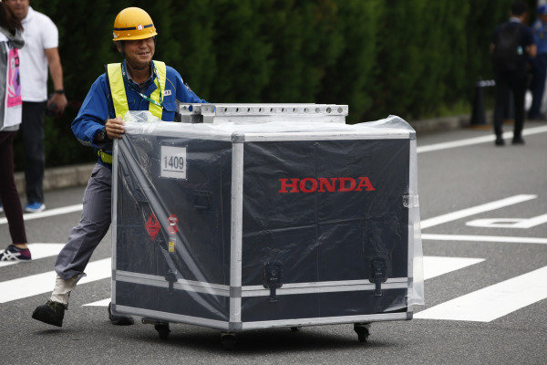A Honda packing crate arrives in the paddock.