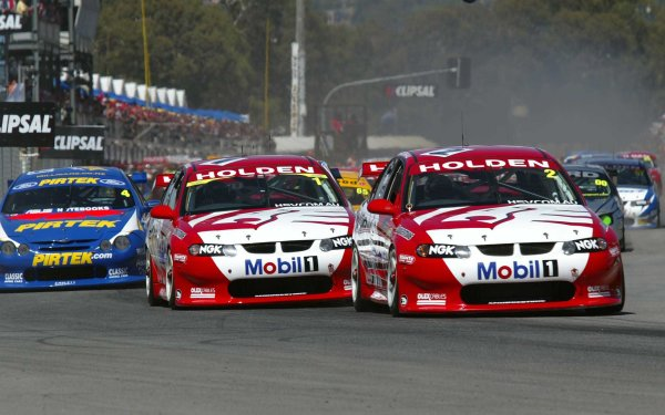 2002 Australian V8 SupercarsAdelaide Clipsal 500. Australia. 17th March 2002.HRT's Jason Bright leads team mate Mark Skaife into the first corner at the start of Race 1.World Copyright: Mark Horsburgh/LAT Photographicref: Digital Image Only