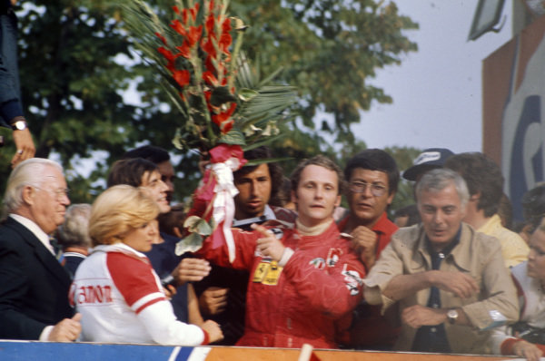 Niki Lauda celebrates third place on the podium.