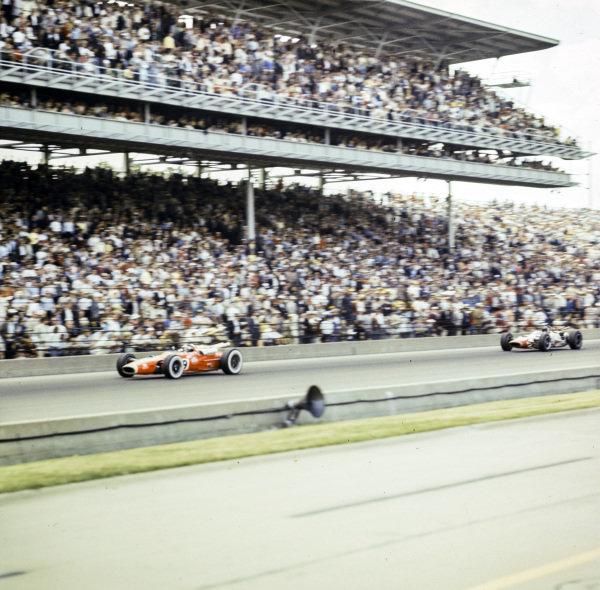Jim Clark, Lotus 38 Ford, leads Jackie Stewart, John Mecom, Lola T90 Ford.