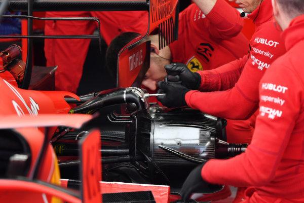 Ferrari mechanics work on Charles Leclerc's Ferrari SF1000