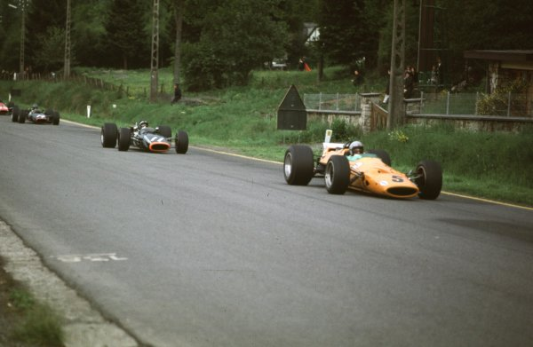 1968 Belgian Grand Prix.Spa-Francorchamps, Belgium.7-9 June 1968.Bruce McLaren (McLaren M7A-Ford) leads Pedro Rodriguez (BRM P133) and Piers Courage (BRM P126). McLaren and Rodriguez finished in 1st and 2nd positions respectively.Ref-68 BEL 05.World Copyright - LAT Photographic