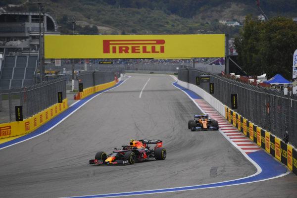 Alexander Albon, Red Bull RB15, leads Lando Norris, McLaren MCL34