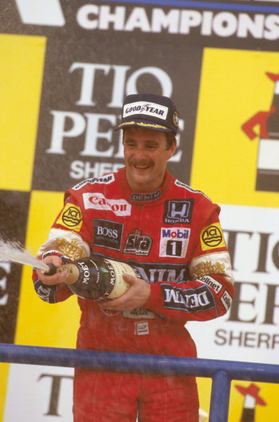 Jerez, Spain.25-27 September 1987.Nigel Mansell (Williams Honda) celebrates 1st position on the podium.Ref-87 ESP 01.World Copyright - LAT Photographic