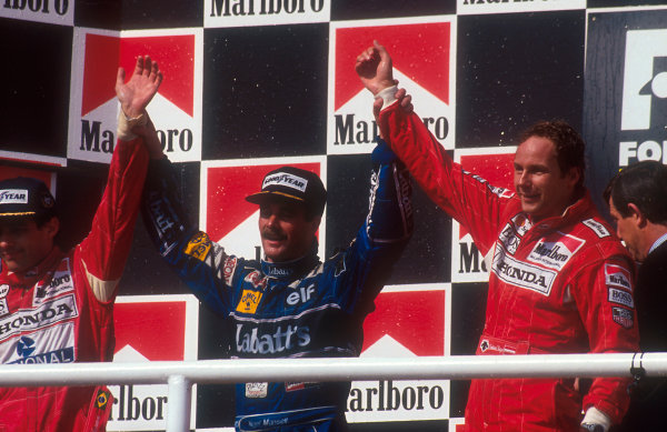 1992 Hungarian Grand Prix.Hungaroring, Budapest, Hungary.14-16 August 1992.Nigel Mansell (Williams Renault) celebrates 2nd position on the podium and winning the drivers World Championship. Ayrton Senna, 1st position and teammate Gerhard Berger, 3rd position (both McLaren Honda) also congratulate him.Ref-92 HUN 14.World Copyright - LAT Photographic