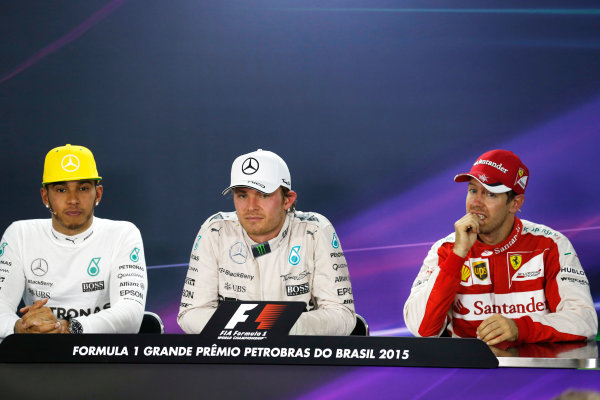 Interlagos, Sao Paulo, Brazil. Sunday 15 November 2015. Nico Rosberg, Mercedes AMG, 1st Position, Lewis Hamilton, Mercedes AMG, 2nd Position, and Sebastian Vettel, Ferrari, 3rd Position, in the Press Conference. World Copyright: Alastair Staley/LAT Photographic ref: Digital Image _R6T6398