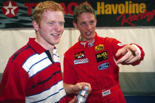 (L to R): Derek Hayes (IRE) talks with team mate Jenson Button (GBR) Haywood Racing. Slick 50 British Formula Ford Championship, Donington Park, England, 16 June 1998.