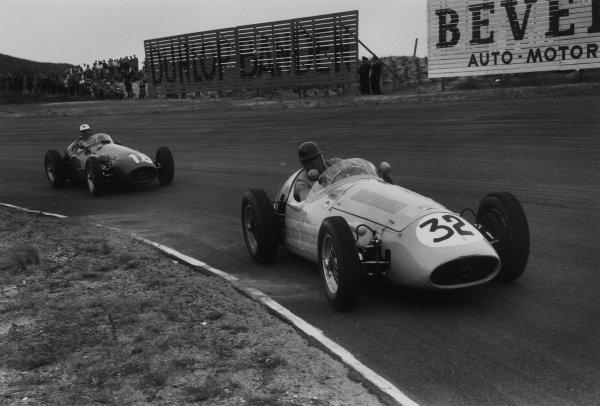 Zandvoort, Holland. 19th June 1955.Horace Gould (Maserati 250F), retired, leads Luigi Musso (Maserati 250F), 3rd position, action. World Copyright: LAT Photographic.Ref:  B/W Print.