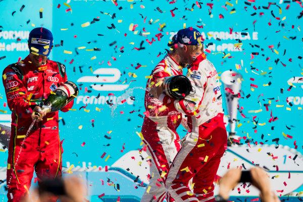 2016/2017 FIA Formula E Championship. Round 7 - Berlin ePrix, Tempelhof Airport, Berlin, Germany. Saturday 10 June 2017. Lucas Di Grassi (BRA), ABT Schaeffler Audi Sport, Spark-Abt Sportsline, ABT Schaeffler FE02, and Felix Rosenqvist (SWE), Mahindra Racing, Spark-Mahindra, Mahindra M3ELECTRO, spray the champagne on the podium. Photo: Zak Mauger/LAT/Formula E ref: Digital Image _54I7719
