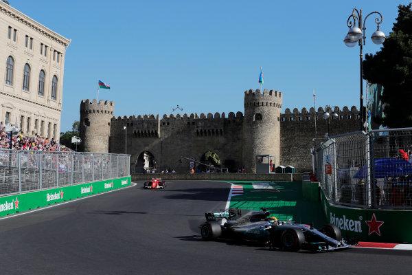 Baku City Circuit, Baku, Azerbaijan. Sunday 25 June 2017. Lewis Hamilton, Mercedes F1 W08 EQ Power+, leads Sebastian Vettel, Ferrari SF70H.  World Copyright: Zak Mauger/LAT Images ref: Digital Image _54I3855