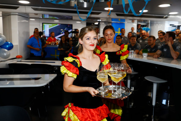 Hungaroring, Budapest, Hungary.  Saturday 29 July 2017. Ladies dressed as Flamenco dancers serve drinks at a birthday celebration for Fernando Alonso, McLaren. World Copyright: Steven Tee/LAT Images  ref: Digital Image _R3I3542