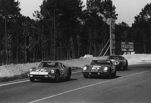 Le Mans, France. 20th - 21st June 1964. Jean Kerguen/Franc (Porsche 904 GTS), 12th position, leads Peter Bolton/Jack Sears (AC Cobra coupe), retired, action.  World Copyright: LAT Photographic. Ref: 11026E - 29-29A.
