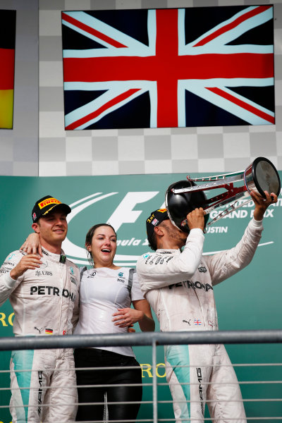 Circuit of the Americas, Austin Texas, USA. Sunday 23 October 2016. Nico Rosberg, Mercedes AMG, 2nd Position, ictoria Vowles, Partner Services Director, Mercedes AMG, and Lewis Hamilton, Mercedes AMG, 1st Position, celebrate on the podium. World Copyright: Sam Bloxham/LAT Photographic ref: Digital Image _SLA2639