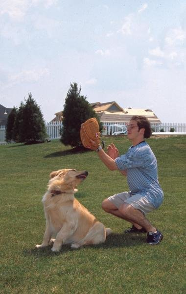 Jacques Villeneuve playing catch with his dog. Formula One Drivers At Home.
