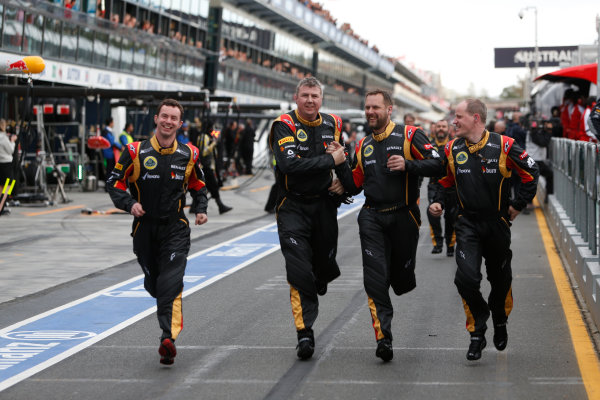 Albert Park, Melbourne, Australia Sunday 17th March 2013 The Lotus team rush to the podium after winning the race. World Copyright: Alastair Staley/  ref: Digital Image _R6T6664