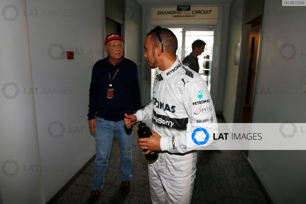 Shanghai International Circuit, Shanghai, China Saturday 13th April 2013 Lewis Hamilton, Mercedes AMG, talks with Niki Lauda. World Copyright: Charles Coates/LAT Photographic ref: Digital Image _N7T4659