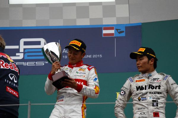 2015 GP2 Series Round 4. Red Bull Ring, Spielberg, Austria. Sunday 21 June 2015. Rio Haryanto (INA, Campos Racing) & Nobuharu Matsushita (JPN, ART Grand Prix)  Photo:  Sam Bloxham/GP2 Media Service ref: Digital Image _G7C6518