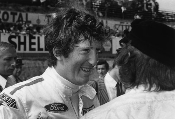 Charade, Clermont-Ferrand, France. 4-6 July 1969.Jochen Rindt (Lotus 49B-Ford Cosworth), 1st position, chats to Jackie Stewart, in the pits, portrait.World Copyright: LAT PhotographicRef: 2565 - 34A.