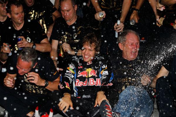 Yas Marina Circuit, Abu Dhabi, United Arab Emirates14th November 2010.Sebastian Vettel, Red Bull Racing RB6 Renault, 1st position, Helmut Marko, Consultant, Red Bull, and the Red Bull team celebrate their championship victories. Portrait. Atmosphere. World Andrew Ferraro/LAT Photographic ref: Digital Image _Q0C7187