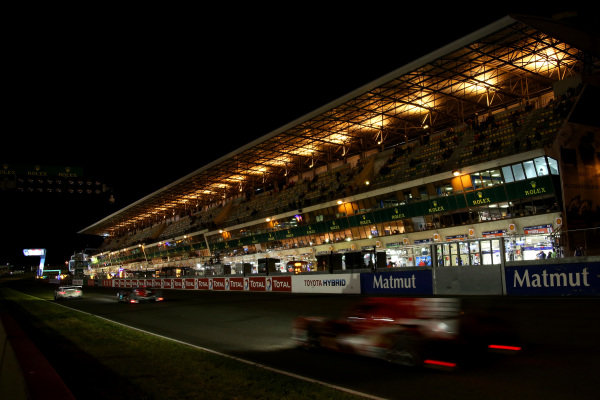 Night action on the main start and finish straight. Le Mans 24 Hours, Le Mans, France, 12-14 June 2014.