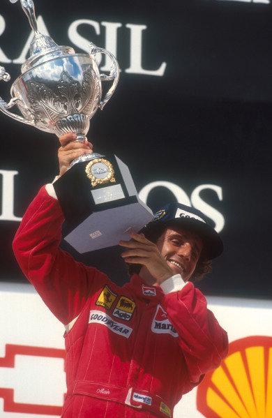 1990 Brazilian Grand Prix.Interlagos, Sao Paulo, Brazil.23-25 March 1990.Alain Prost (Ferrari) celebrates 1st position on the podium.Ref-90 BRA 04.World Copyright - LAT Photographic