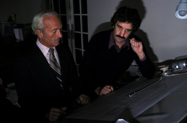 Colin Chapman (GBR) Team owner Lotus oversees one of his designers at work. Lotus Factory Shoot, Ketteringham Hall, Norfolk, England, 1979.