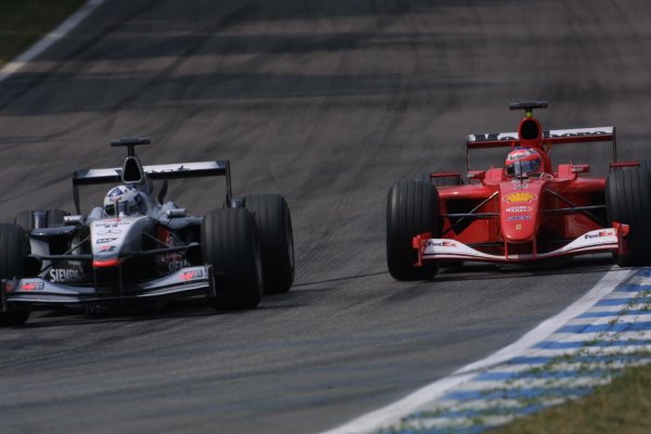 2001 German Grand Prix - RaceHockenheim, Germany. 29th July 2001Rubens Barrichello, Ferrari F2001, passes David Coulthard, West McLaren Mercedes MP4/16, action.World Copyright - LAT PhotographicRef: 9 MB Digital File Only