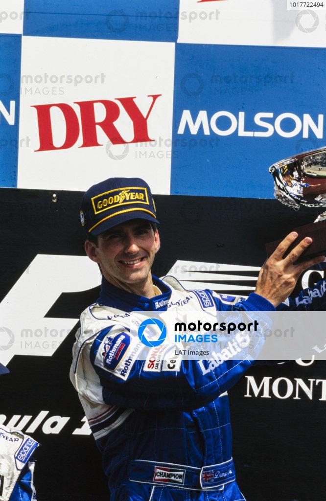 Damon Hill, 1st position, celebrates on the podium.