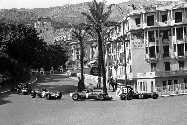 Race retiree Jack Brabham (AUS) Brabham BT7 leads the race winner Graham Hill (GBR) BRM P261, Dan Gurney (USA) Brabham BT7 who retired and John Surtees (GBR) Ferrari 158 who also retired, around the Old Station Hairpin. Monaco Grand Prix, Monte Carlo, 10 May 1964.