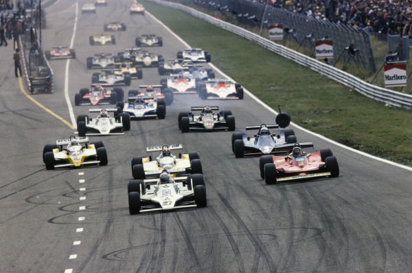 Alan Jones, Williams FW07 Ford leads Gilles Villeneuve, Ferrari 312T4 and Jean-Pierre Jabouille, Renault RS10 as the front left wheel from Clay Regazzoni's Williams FW07 Ford bounces across the track.
