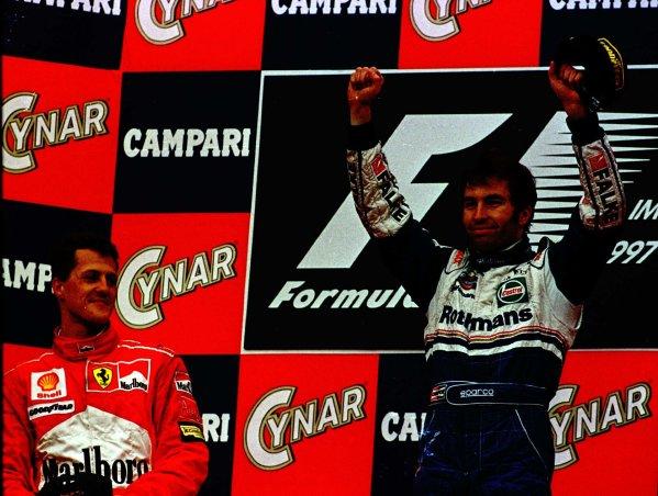 1997 San Marino Grand Prix.Imola, Italy.25-27 April 1997.Heinz-Harald Frentzen (Williams Renault) celebrates on the podium with Michael Schumacher (Ferrari) who finished in 2nd position.World Copyright - LAT Photographic