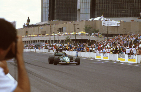 1983 United States Grand Prix East.Detroit, Michigan, USA.3-5 June 1983.Michele Alboreto (Tyrrell 011 Ford) crosses the line for the win.Ref-83 USA 12.World Copyright - LAT Photographic