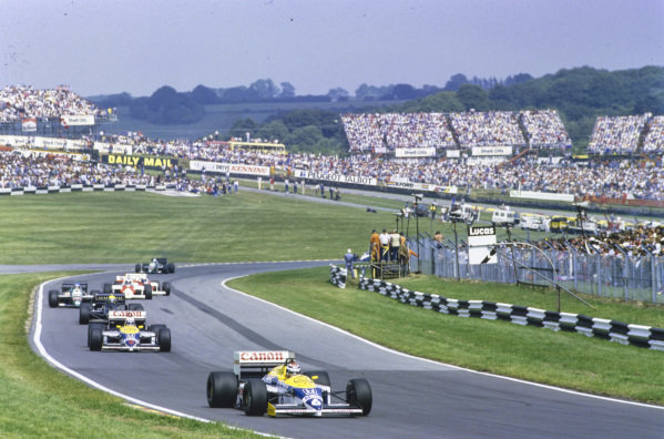 Nelson Piquet, Williams FW11 Honda, leads Nigel Mansell, Williams FW11 Honda, Ayrton Senna, Lotus 98T Renault, Gerhard Berger, Benetton B186 BMW, Keke Rosberg, McLaren MP4-2C TAG, Alain Prost, McLaren MP4-2C TAG, and Teo Fabi, Benetton B186 BMW.
