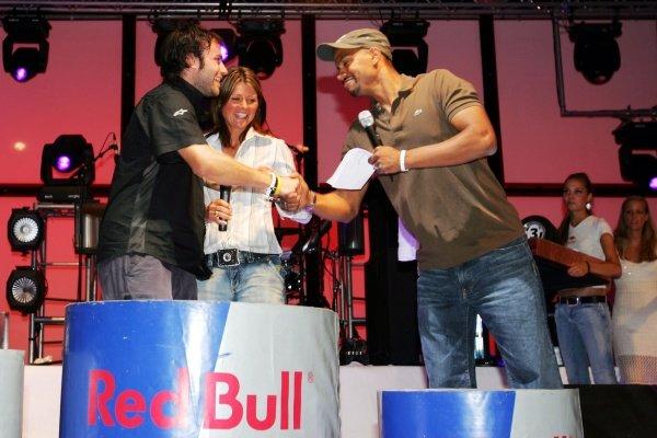 Brendon Thorne (AUS) (Left) Sutton Motorsport Images Photographer celebrates his third position on the podium. Red Bull Hockenheim Petit Prix, Mannheim, Germany, 23 July 2005. DIGITAL IMAGE