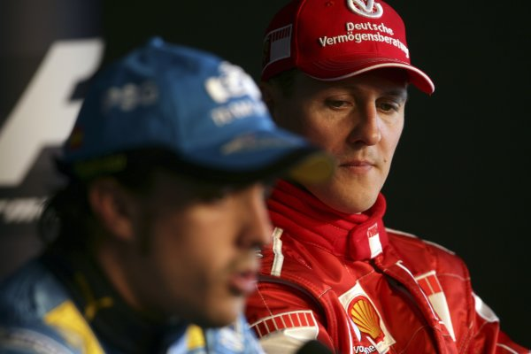 2006 British Grand Prix - Saturday Qualifying Silverstone, England. 8th - 11th June. Fernando Alonso, Renault R26 and Michael Schumacher, Ferrari 248F1 take questions in the FIA pole winners press conference, portrait. World Copyright: Charles Coates/LAT Photographic ref: Digital Image ZK5Y2305