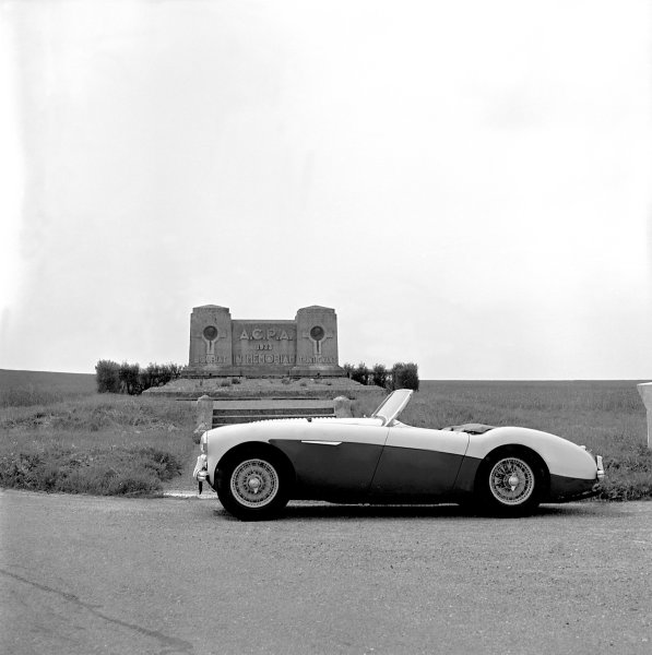 Austin-Healey 100M in front of memorial for racing drivers Guy Bouriat & Louis Trintignant on Peronne circuit, France, 1956.World Copyright: LAT Photographicref: LAT 557