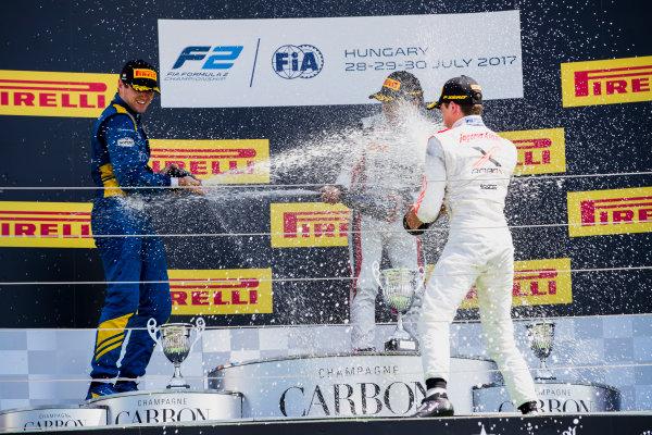 2017 FIA Formula 2 Round 7. Hungaroring, Budapest, Hungary. Sunday 30 July 2017. Oliver Rowland (GBR, DAMS), Nobuharu Matsushita (JPN, ART Grand Prix), Nyck De Vries (NED, Rapax).  Photo: Zak Mauger/FIA Formula 2. ref: Digital Image _54I4968