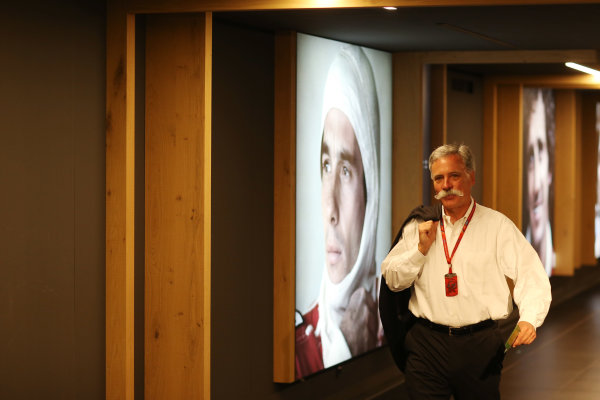 Red Bull Ring, Spielberg, Austria. Sunday 9 July 2017. Chase Carey, Chairman, Formula One, walks past a portrait of Ayrton Senna. World Copyright: Charles Coates/LAT Images ref: Digital Image AN7T3647