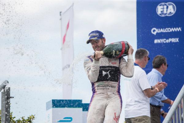 2016/2017 FIA Formula E Championship. Round 9 - New York City ePrix, Brooklyn, New York, USA. Saturday 15 July 2017. Sam Bird (GBR), DS Virgin Racing, Spark-Citroen, Virgin DSV-02, sprays the champagne on the podium. Photo: Andrew Ferraro/LAT/Formula E ref: Digital Image _FER8698